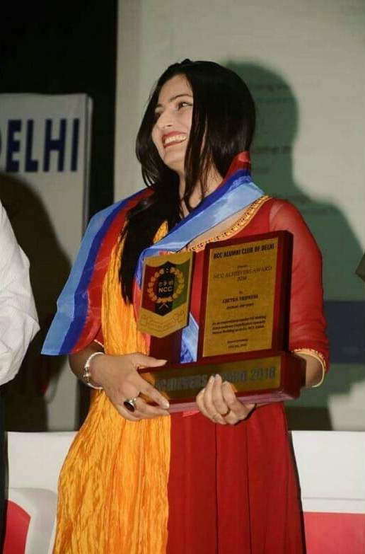 Chitra Tripathi with award