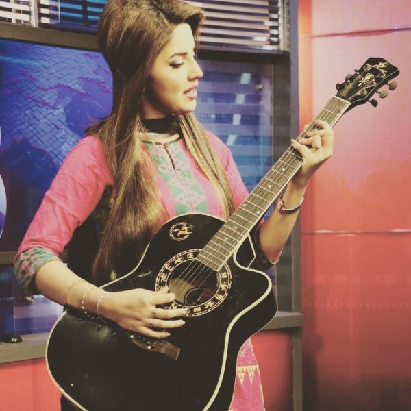 Kiran Naz playing the guitar