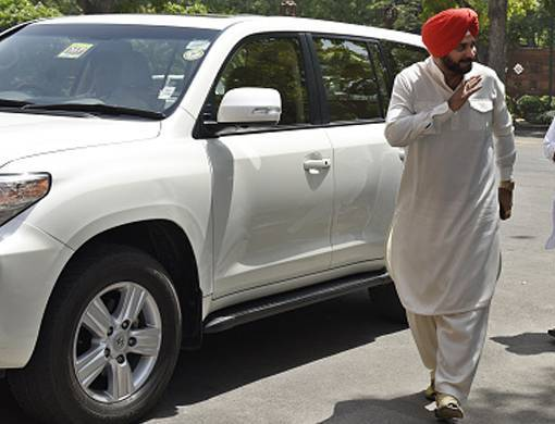 Navjot Singh Sidhu with his car