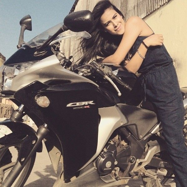 Nia Sharma riding a bike