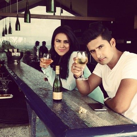 Nia Sharma with a glass of wine