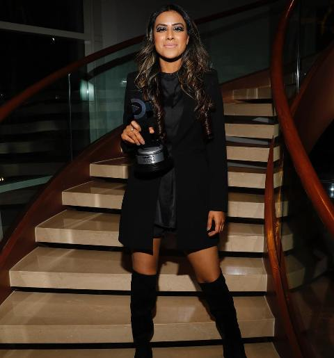 Nia Sharma with an Award
