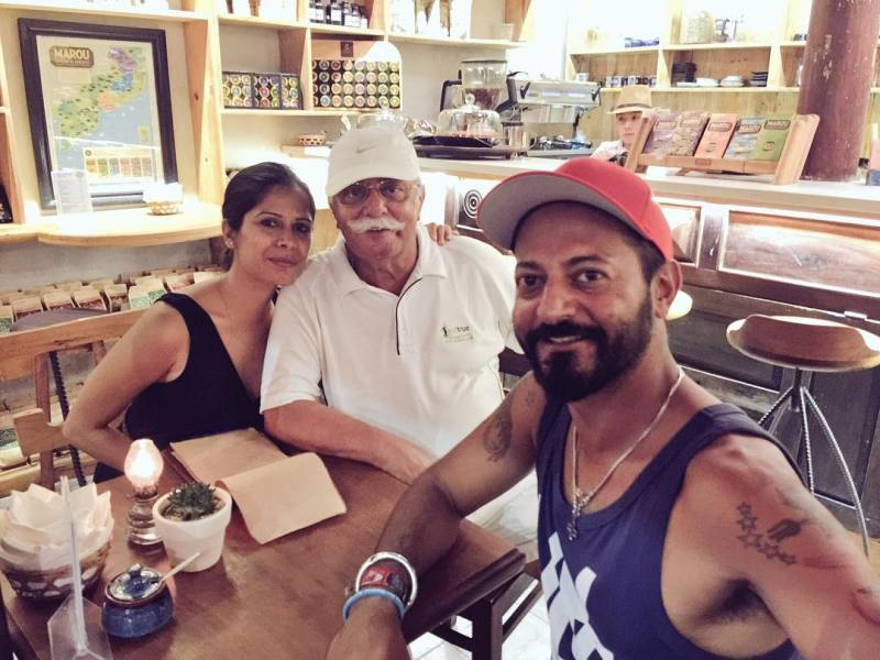 Nikhil Chinapa at his favourite restaurant with his wife and father