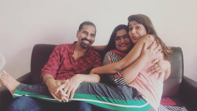 Rasika Sunil with her parents