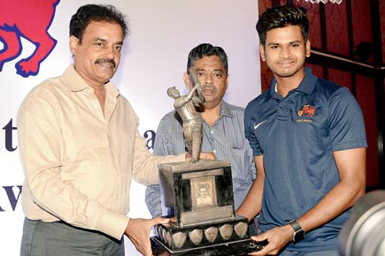 Shreyas Iyer with S V Rajadyaksha trophy