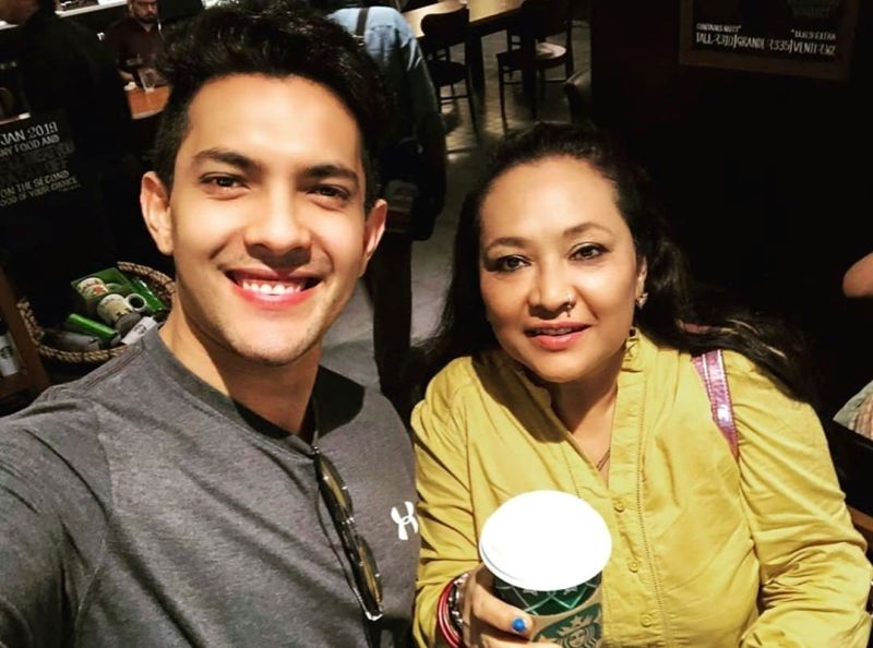 Aditya Narayan with his mother