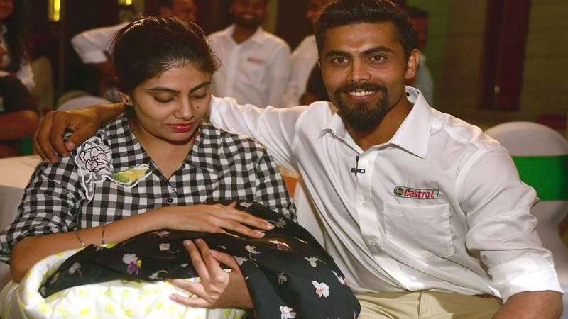 Ravindra Jadeja with his wife and daughter
