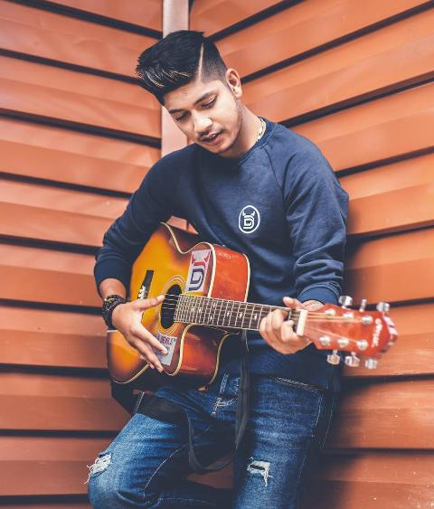 Sandeep Lamichhane playing guitar
