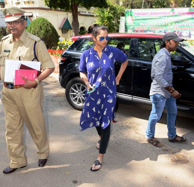 Sania Mirza coming out of her Range Rover car