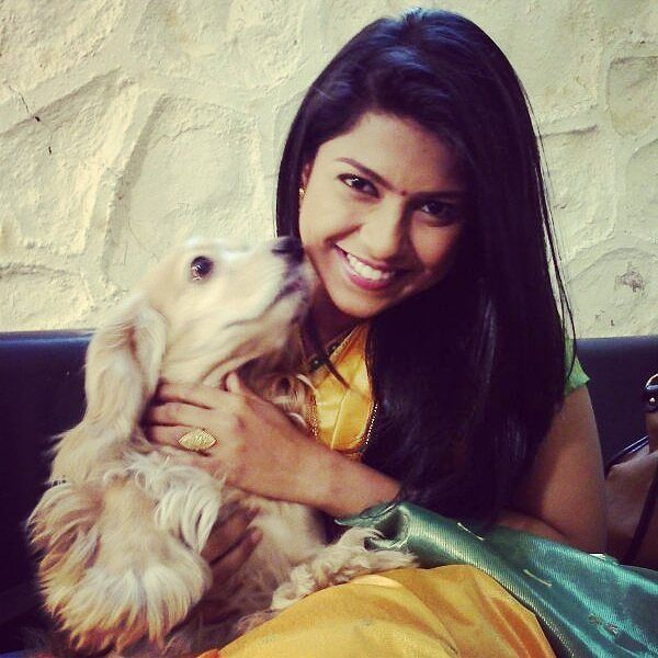 Swarda Thigale with her pet dog