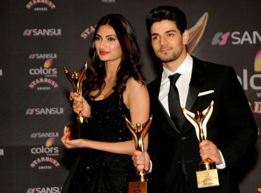 Athiya Shetty and Sooraj Pancholi with awards
