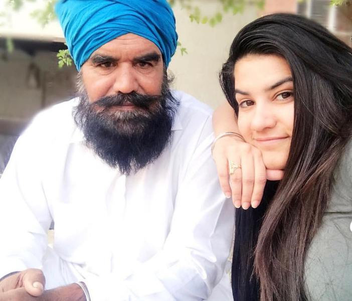Kaur B with her father