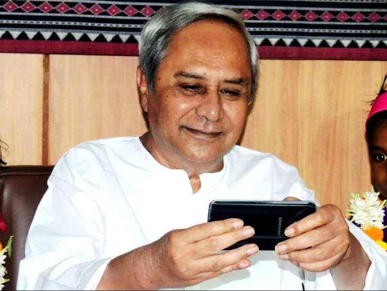 Naveen Patnaik Using A Mobile Phone