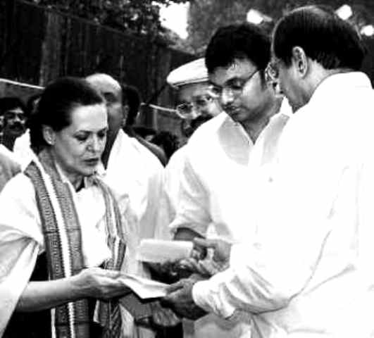 P Chidambaram formally handing the merger papers of his party with the INC