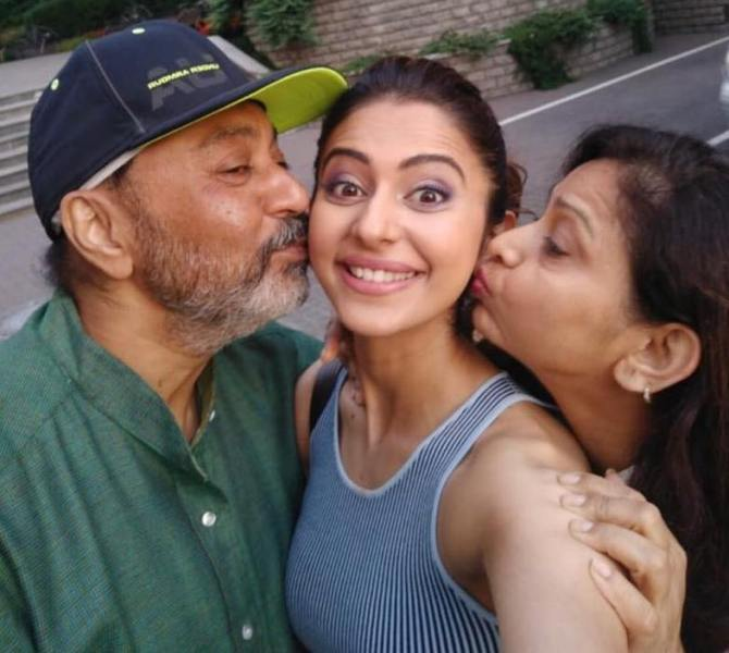 Rakul Preet Singh with her mother and father
