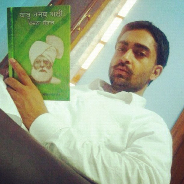 Sharry Mann reading a book