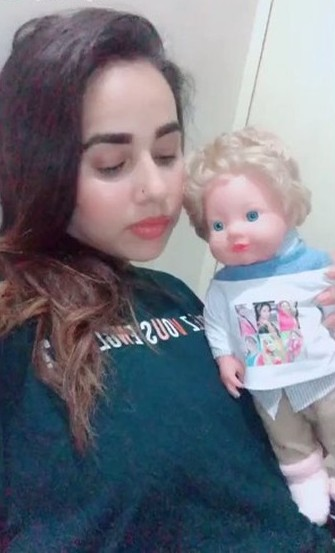 Sunanda Sharma with her doll
