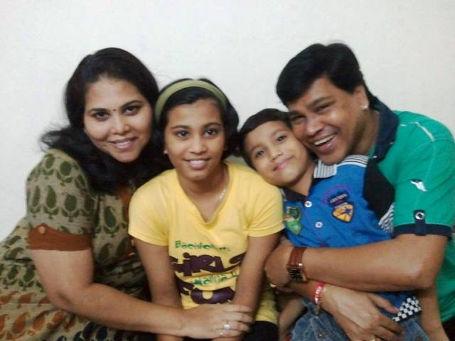 Digamber Naik with his wife and children