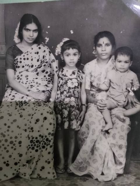 Fathima Babu (center) childhood photo