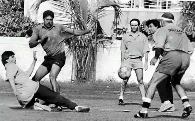 Kapil Dev and Shah Rukh Khan playing football
