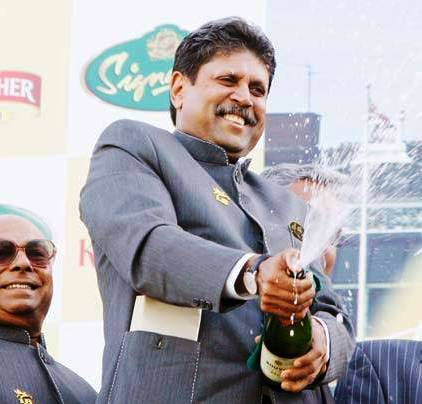 Kapil Dev while opening the Champagne bottle