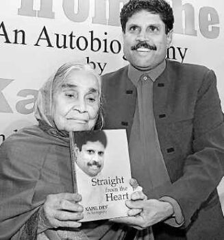 Kapil Dev with his mother and his autobiography, Straight from the Heart