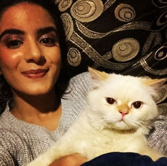 Nikki Sharma with her pet cat