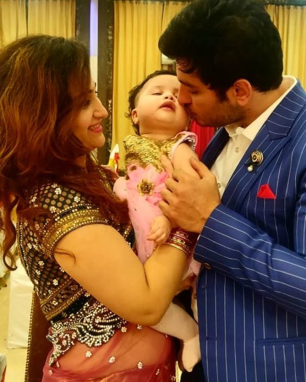 Ali Reza with his wife and daughter