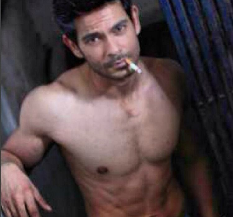 Keith Sequeira smoking cigarette