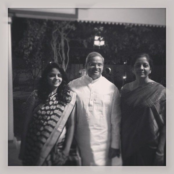 Prakala Prabhakar with his wife and daughter