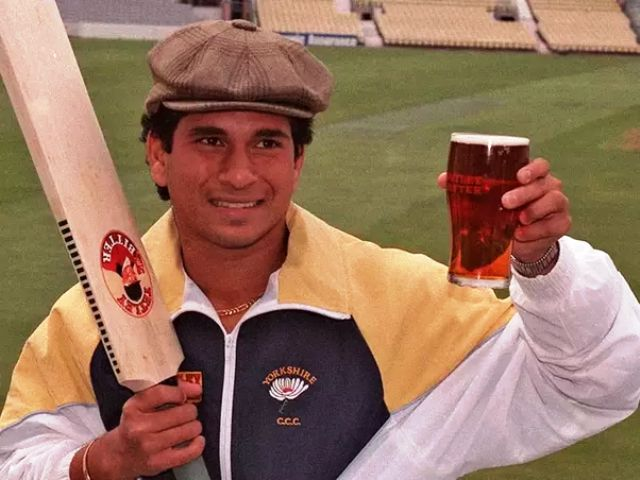 Sachin Tendulkar with a glass of alcohol