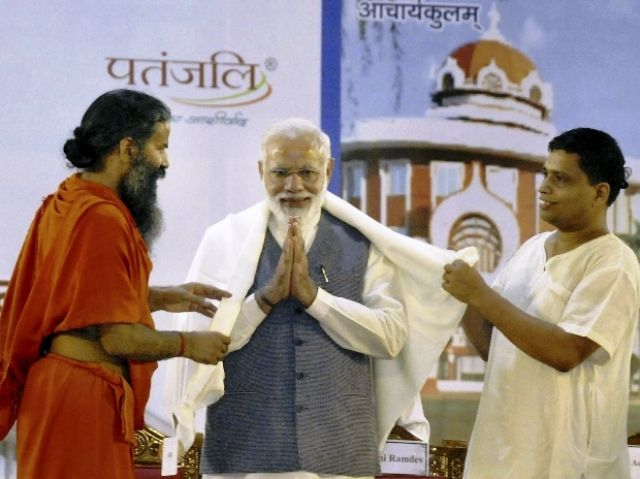 Acharya Balkrishna with Baba Ramdev and Narendra Modi
