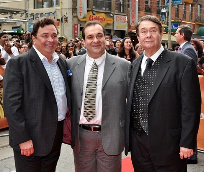 From leftArmaan Jain's Maternal Uncles, Rishi Kapoor, Rajiv Kapoor and Randhir Kapoor, all sons of famed Bollywood star Raj Kapoor, stand for a photo on the Red Carpet during the Raj Kapoor Family Tribute event during the iifa Film Festival at the TIFF Bell Light Box in Toronto on Sunday, June 26, 2011. (AP Photo/The Canadian Press, Aaron Vincent Elkaim)