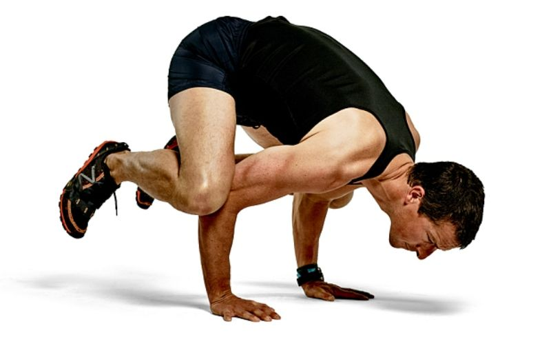 Bear Grylls doing Kaakasana