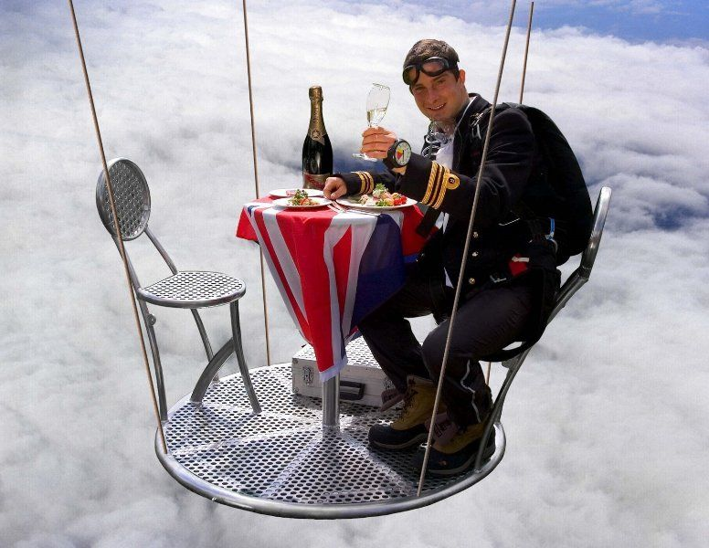 Bear Grylls having dinner on the air