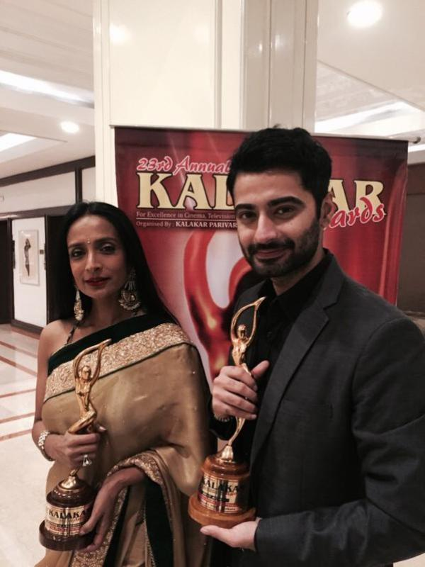 Harshad Arora posing with an Award