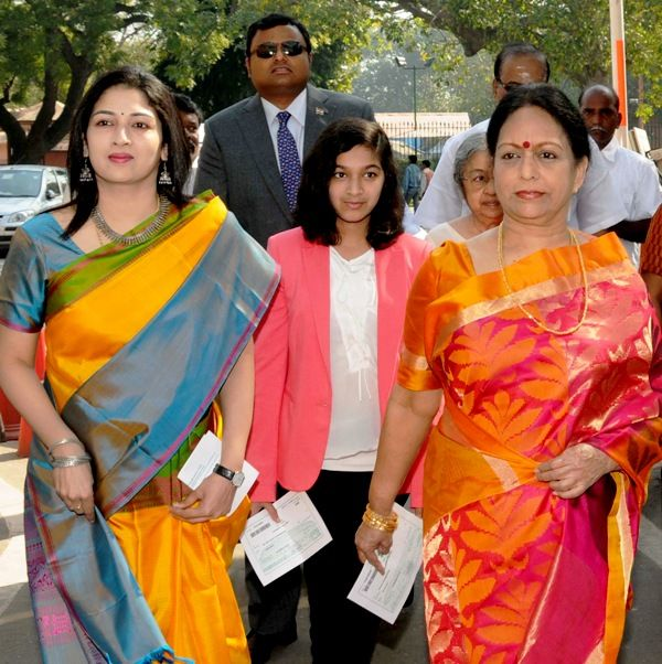 Karti Chidambaram with his Mother (right), Wife (left), and Daughter (centre)