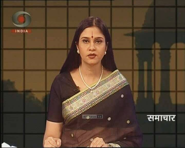 Neelum Sharma, anchoring a news show on DD INDIA