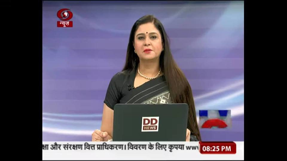 Neelum Sharma, anchoring a news show on DD News