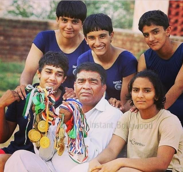 Phogat Sisters with their father