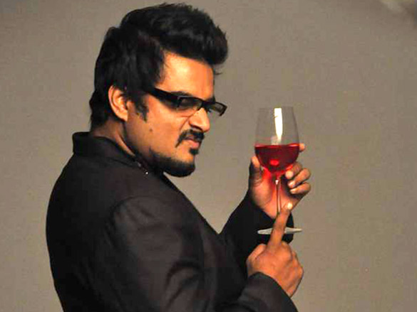 R. madhavan with a glass of alcohol