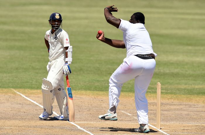 Rahkeem Cornwall bowling against India