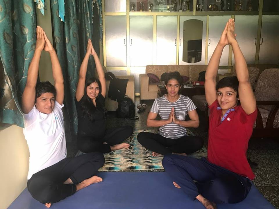 Sangeeta Phogat doing yoga with her sisters