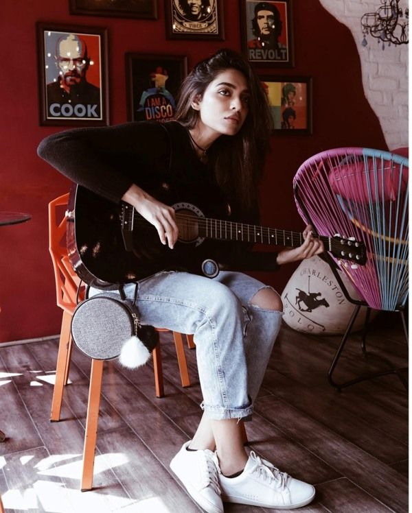 Sobhita Dhulipala playing her guitar