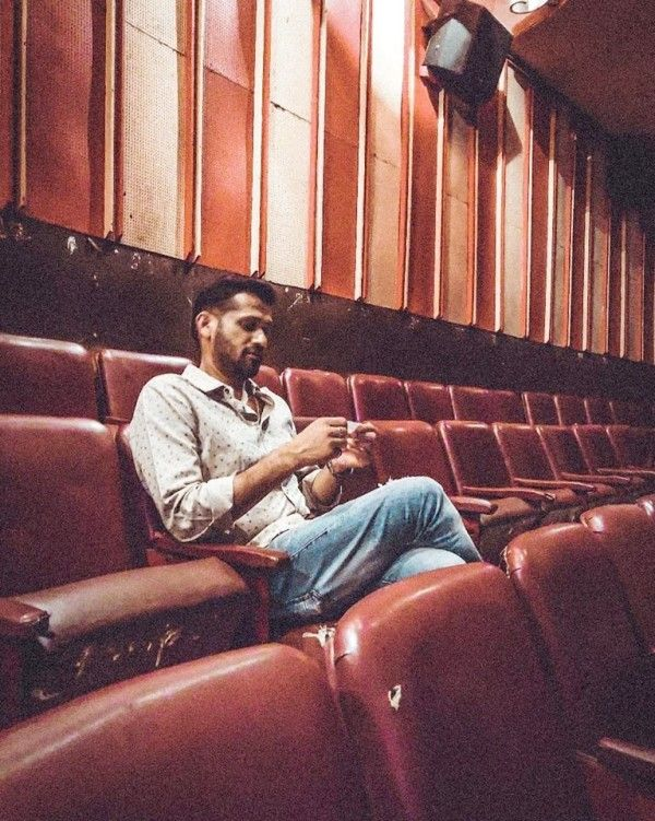 Soham Shah sitting in a Theatre to watch DDLJ