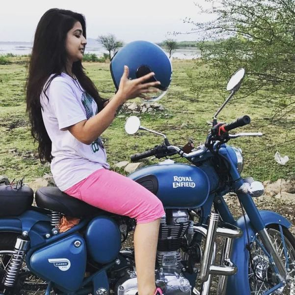 Starnick posing with her Royal Enfield