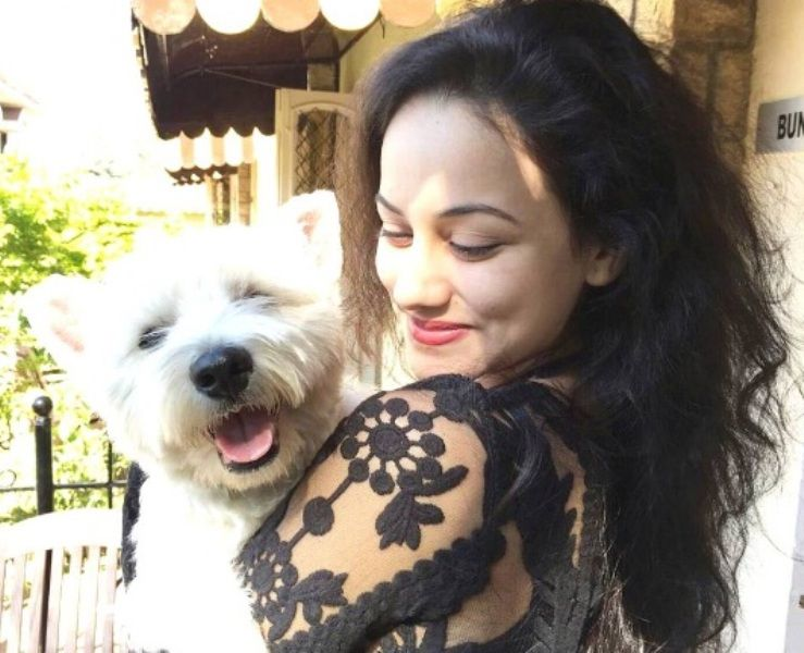 Urvashi Pardeshi with her pet dog