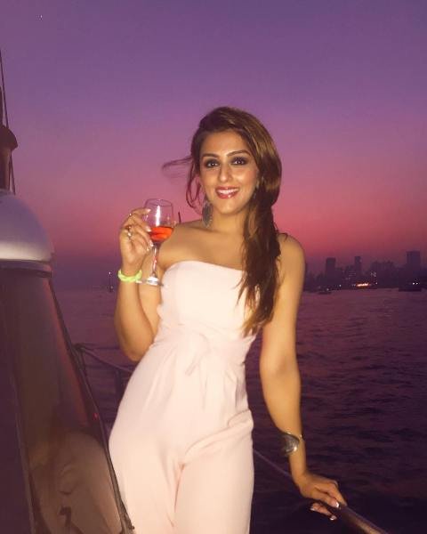 Aarti Chabria with a glass of wine