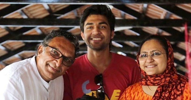 Abi Hassan with his parents