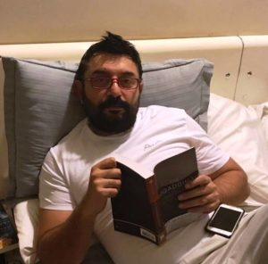 Arvind Swami Reading a Book